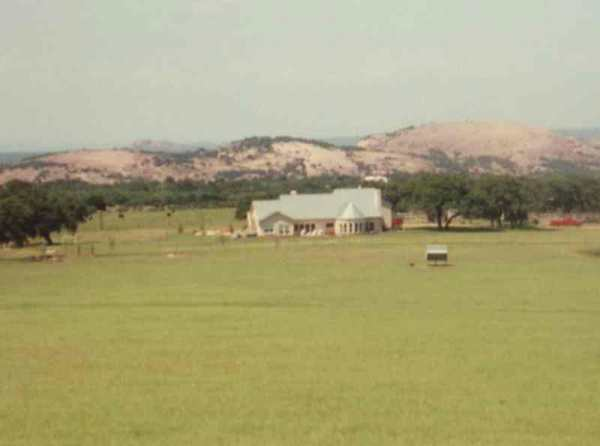 Ranch house with Enchanted Rock in background