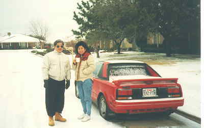 Angie and her father with Lorrie's MR2 after snow storm