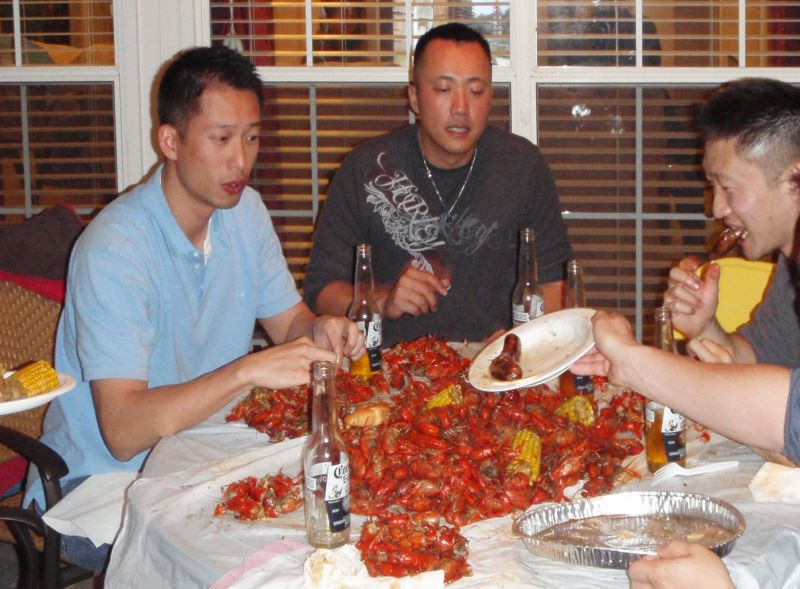 Ben, Lewis and Russ Tong chowing down on crawfish
